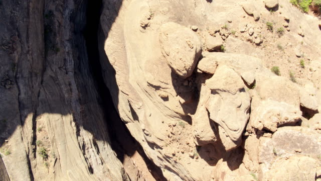 colorado river flowing through slot canyon in utah - drone shot - rock formation stock videos & royalty-free footage
