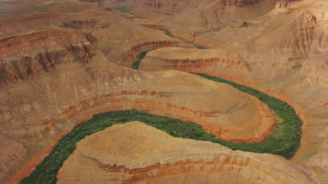 aerial colorado river leaving a green trail of vegetation in grand canyon - river colorado stock videos & royalty-free footage