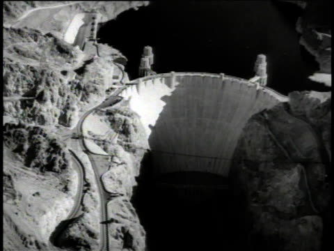 1949 aerial colorado river meeting the hoover dam / nevada-arizona, united states - hoover dam stock videos and b-roll footage