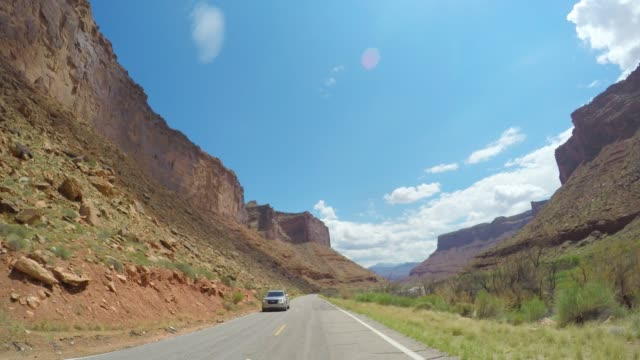 colorado river rapids and rock cliffs near moab utah - named wilderness area stock videos & royalty-free footage