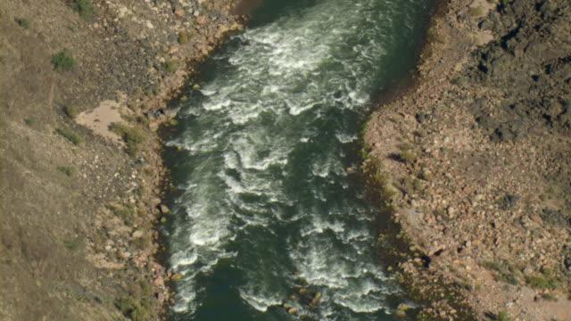 Colorado River rapids flow through the Grand Canyon.