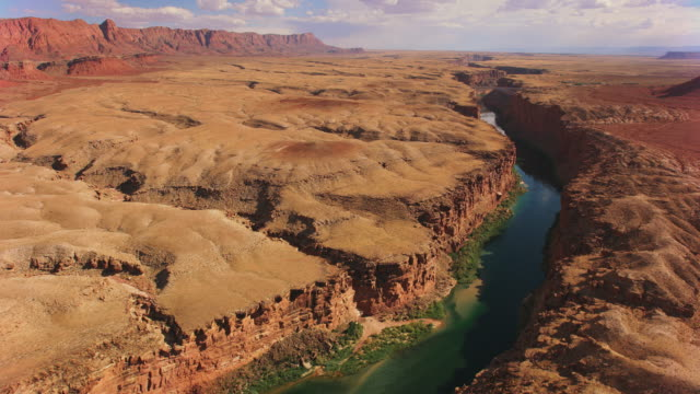 aerial colorado river running its course surrounded by steep cliffs - river colorado stock videos & royalty-free footage