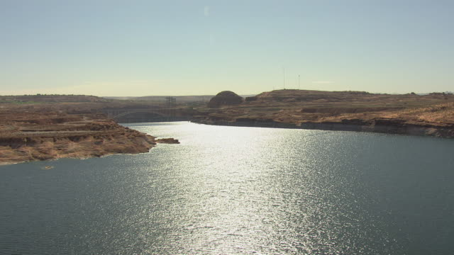 ws aerial colorado river with glen canyon dam in coconino county / arizona, united states - glen canyon staudamm stock-videos und b-roll-filmmaterial