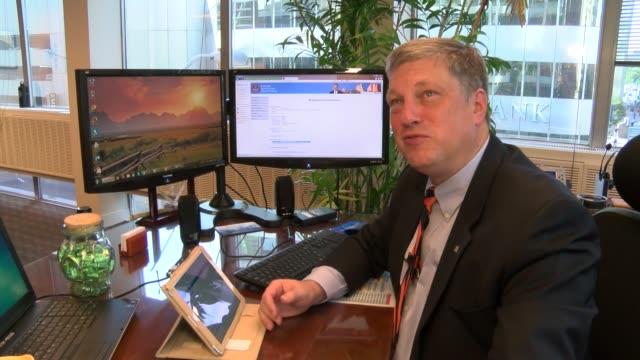 Colorado Secretary of State Wayne W Williams explains online voter registration for multiple devices including smartphone tablet and desktop computer...