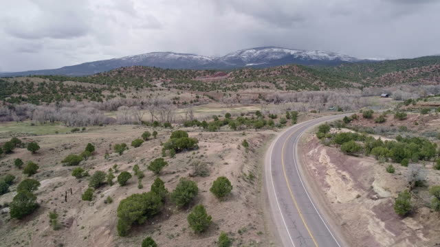 colorado state highway 131 in colorado mountains, nearby mccoy, in the early spring. aerial drone video with the panoramic camera motion. - deer stock videos & royalty-free footage