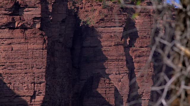 colorado-based videographer has captured time-lapse footage of sunlight creating a shadow effect of a bearded man on a cliff face along the seven... - illusion stock videos & royalty-free footage
