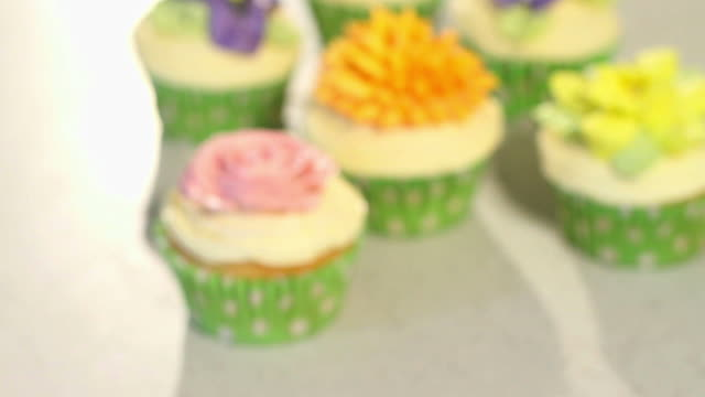 colored decorated cupcakes Blur to sharp Focus