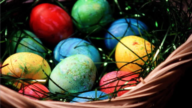 colored easter eggs in basket - basket stock videos & royalty-free footage