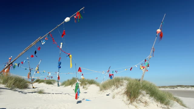 colored flags at the beach - north frisian islands stock videos & royalty-free footage