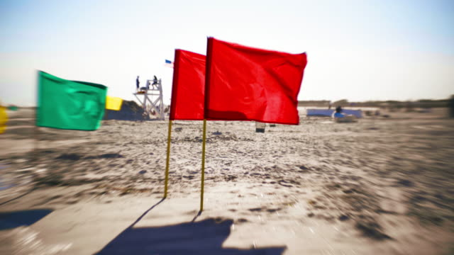 colored flags at the jones beach, long island, new york, usa - lifeguard chair stock videos & royalty-free footage