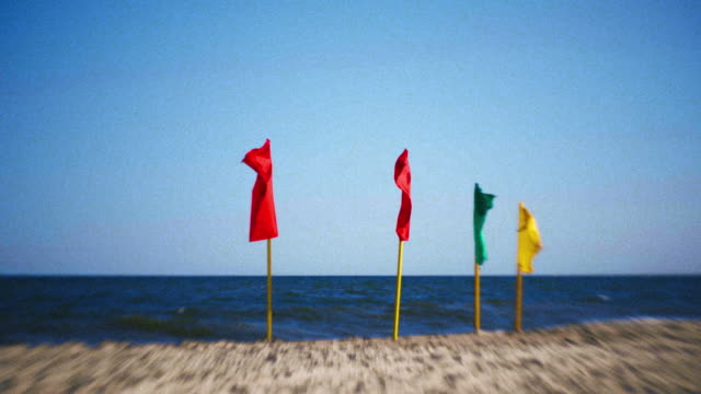 colored flags at the jones beach, long island, new york, usa - bright colour stock videos & royalty-free footage