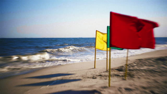 colored flags at the jones beach, long island, new york, usa - water's edge stock videos & royalty-free footage