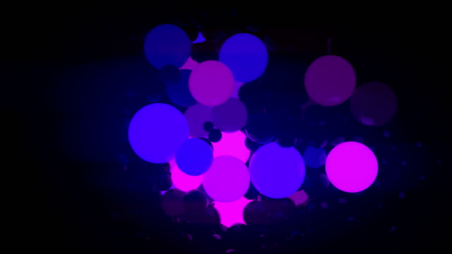 colored glowing balls on black background. digital animation 3d rendering. 4k, ultra hd resolution - contrasts stock videos and b-roll footage
