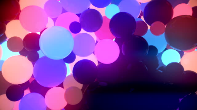 colored glowing balls on black background. digital animation 3d rendering - neon colored stock videos & royalty-free footage