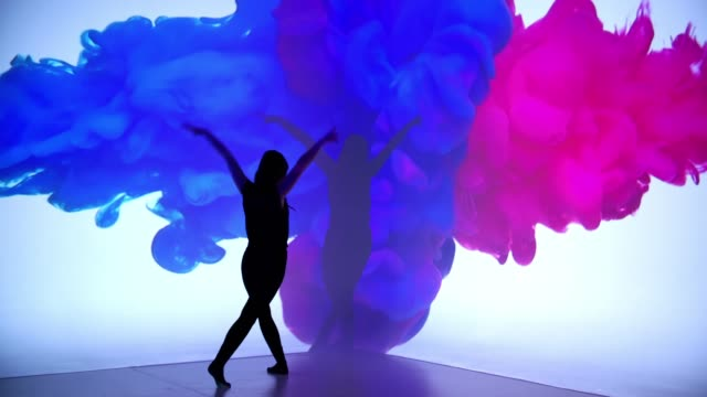 colored ink projection upon a female dancer - modern dancing stock videos & royalty-free footage