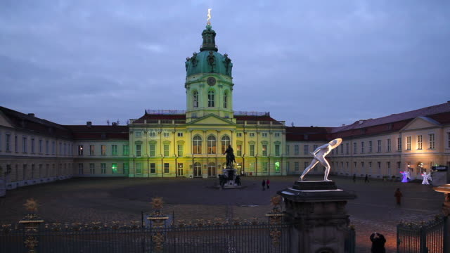 colored lights illuminate the charlottenburg palace in berlin. - charlottenburg palace stock videos & royalty-free footage