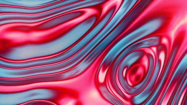 色付きの金属表面ホログラフィック波の背景。抽象的なカラフルなグラデーション。カラフルなグラフィックコンセプト。3d レンダリングデジタルシームレスループアニメーション。4k、ウ� - アルミホイル点の映像素材/bロール