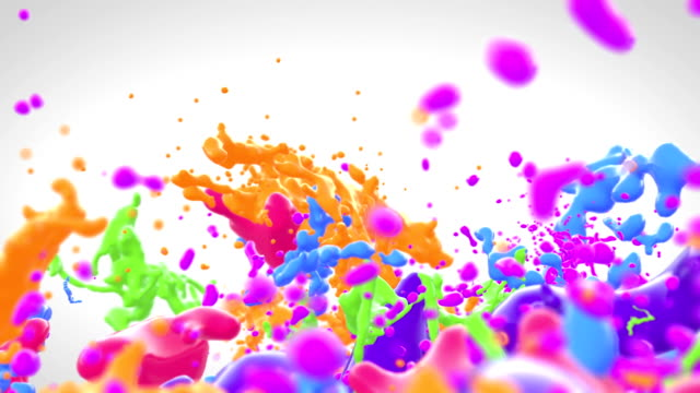 Colored paint splashes in slow motion