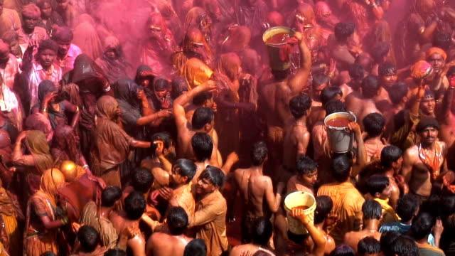 Colored powder fills the air during the Holi Festival.