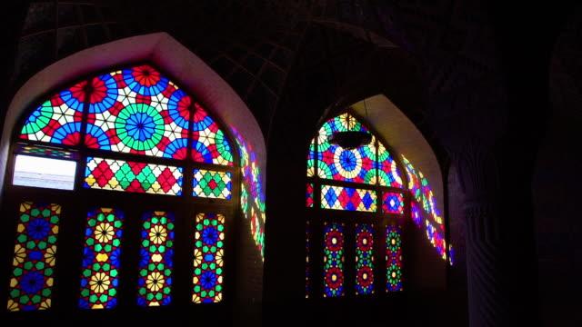 vídeos de stock, filmes e b-roll de colored reflection of glasses on the arch of a building - armação de janela