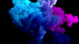 Colored smoke explosion on black