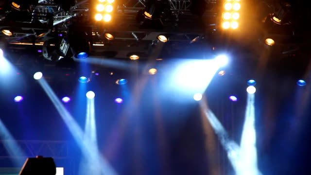 colored spotlights at concert. - floodlight stock videos & royalty-free footage