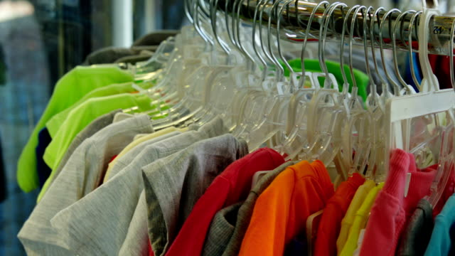 colored t-shirts in the store - t shirt stock videos & royalty-free footage