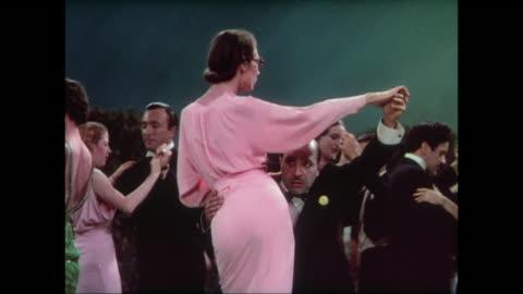 1937 colorful and classy crowd ballroom dance during dinner at the casino moderne - 1937 bildbanksvideor och videomaterial från bakom kulisserna