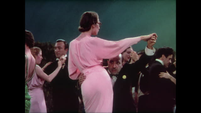 1937 colorful and classy crowd ballroom dance during dinner at the casino moderne - 高い点の映像素材/bロール