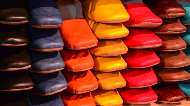 stockvideo's en b-roll-footage met colorful arab shoes for sale in store on rack in morocco fez - sale