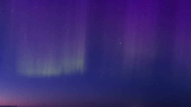 colorful aurora at twilight - polarlicht stock-videos und b-roll-filmmaterial