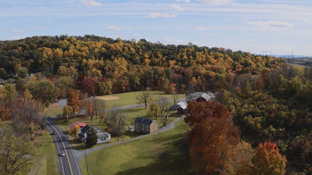 colorful autumn in rural pennsylvania. aerial scenic views on the small village nearby lehigh township, between mountains covered by the woods. aerial video with the panning camera motion. - pennsylvania stock videos & royalty-free footage