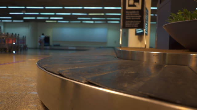 Colorful baggage belt moving