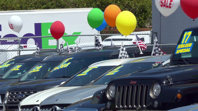 colorful balloons on cars during sales event at dealership showroom in los angeles, california, 4k - western usa stock videos & royalty-free footage