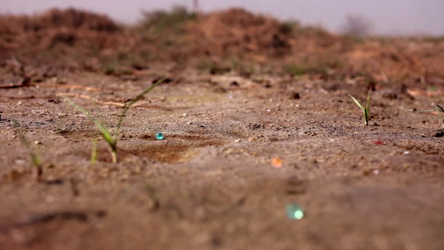 Colorful balls falling on ground