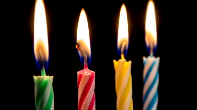 Colorful Birthday Candles Burning Down