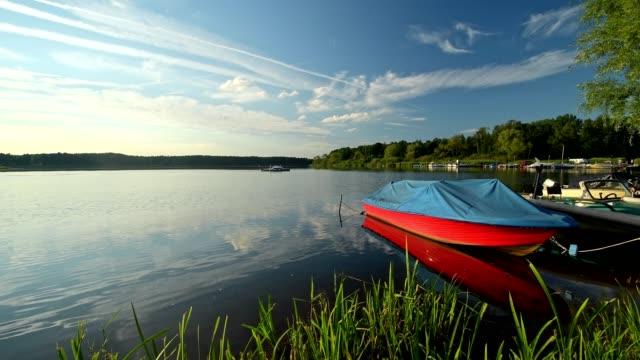Colorful boats in the lake, Lake Neuendorfer See, Märkische Heide, Brandenburg, Germany