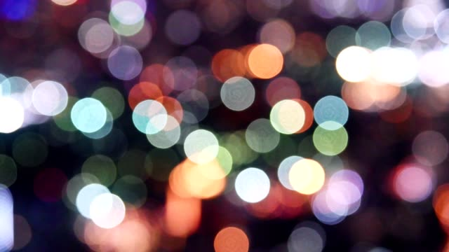 colorful bokeh lights glittering of traffic background - toned image stock videos & royalty-free footage