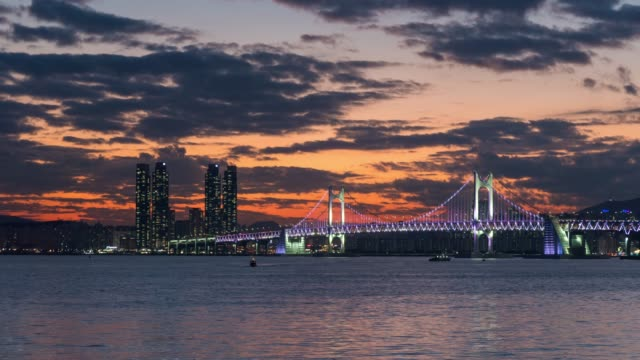colorful bridge night in busan, south korea cityscape panorama,cityscape of haeundae district with  high rise skyscraper buildings,modern city business district background - busan stock videos & royalty-free footage