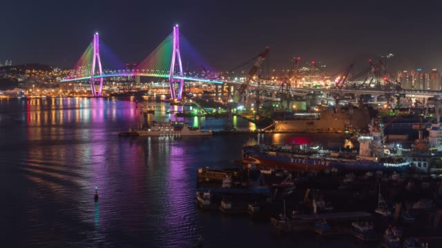colorful bridge night in busan, south korea cityscape panorama,cityscape of yeongdo-gu district with luxury skyscrapers - busan stock videos & royalty-free footage