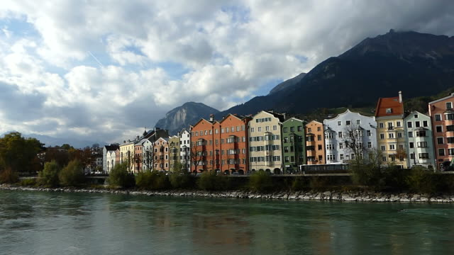 colorful building along inn river in innsbruck, austria - inn river stock videos and b-roll footage