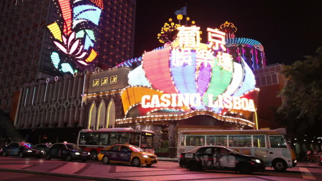 WS Colorful casino signs glowing at night / Macao, China