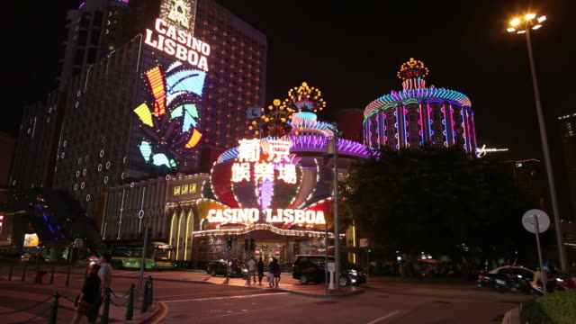 ws colorful casino signs glowing at night / macao, china - macao stock videos & royalty-free footage