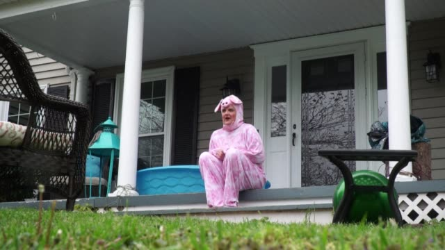 a colorful cast of characters appear day after day on a porch in the us state of virginia urging people to stay upbeat and stay home during the... - virginia us state stock videos & royalty-free footage