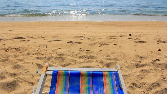 colorful chair on sandy beach