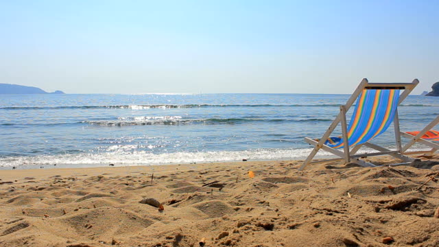 colorful chair on sandy beach - chair stock videos and b-roll footage