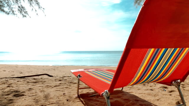 colorful chair on the beach - rear view stock videos & royalty-free footage