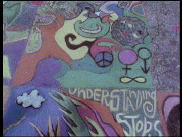 colorful chalk drawings of cnd signs and the words 'understanding stops action' amongst other hippy drawings of flowers and signs tilt up to hippies drawing 1967 - symbol stock videos & royalty-free footage