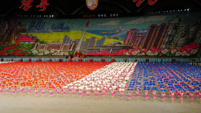 colorful cheerleader perfomance during mass games in pyongyang, north korea, dprk. wide shot - north korea stock videos & royalty-free footage
