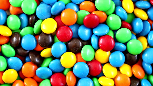 colorful chocolate candy - 3 videos in 1 (full hd) - take away food stock videos and b-roll footage